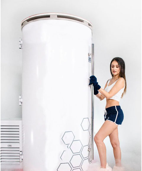 Girl standing near cryotherapy machine